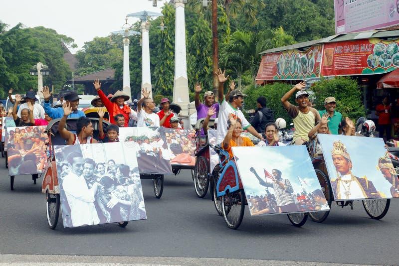 Jokowi Cebration. Treecycle rider at Solo celebrating Joko-Jokowi-Widodo after winning presidential election stock image