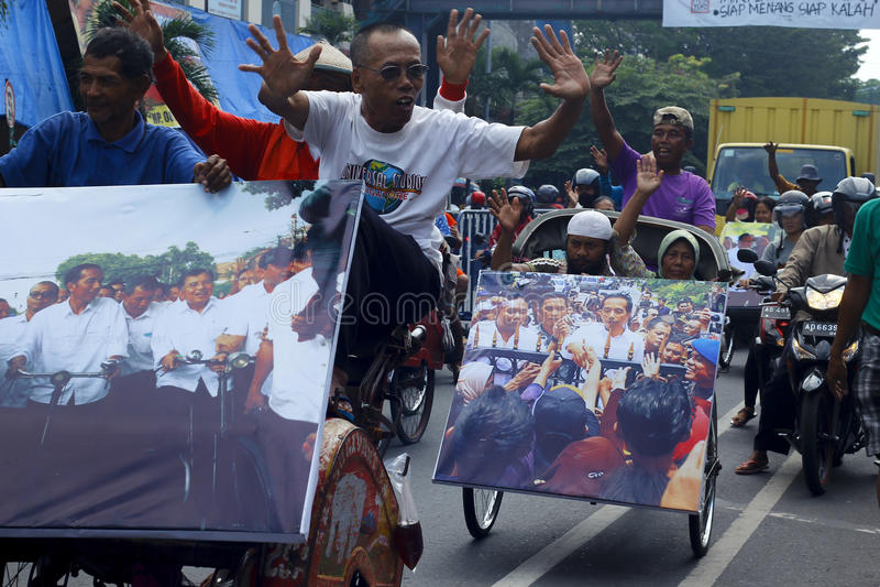 Jokowi Cebration. Treecycle rider at Solo celebrating Joko-Jokowi-Widodo after winning presidential election royalty free stock photos