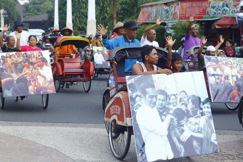 Jokowi Cebration. Treecycle rider at Solo celebrating Joko-Jokowi-Widodo after winning presidential election royalty free stock images