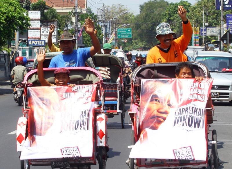 Jokowi for president. Some of indonesia threesaw jockey doing action to support Jakarta Governor, Joko Widodo (Jokowi) to become Indonesia President in 2014 royalty free stock image