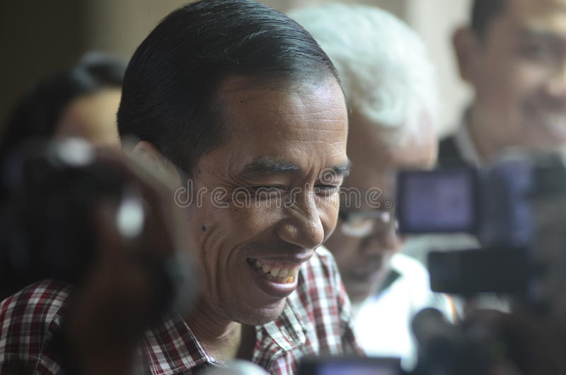 JOKOWI'S PROTECTIONISM. Indonesia's President Joko Widodo, or Jokowi, at his hometown in Solo, Java, Indonesia. Widodo's government is reacting to a royalty free stock photo