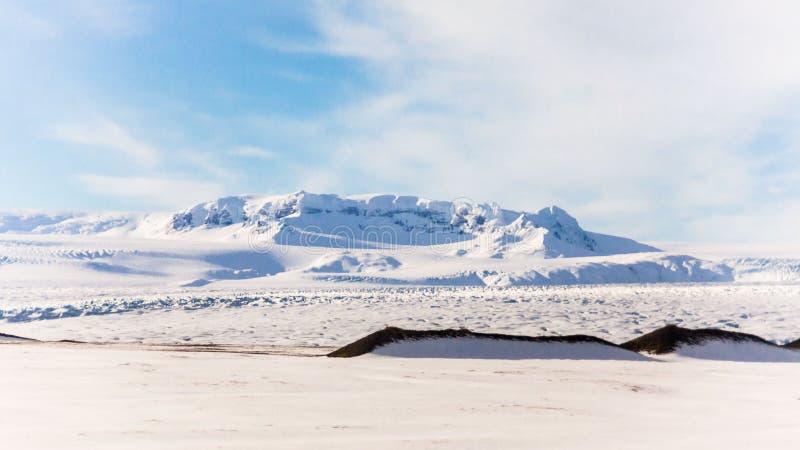 Jokulsarlon snow landscape in Hvannadalshnukur. Jökulsárlón is a glacial lagoon, bordering Vatnajökull National Park in southeastern Iceland. Its royalty free stock photo