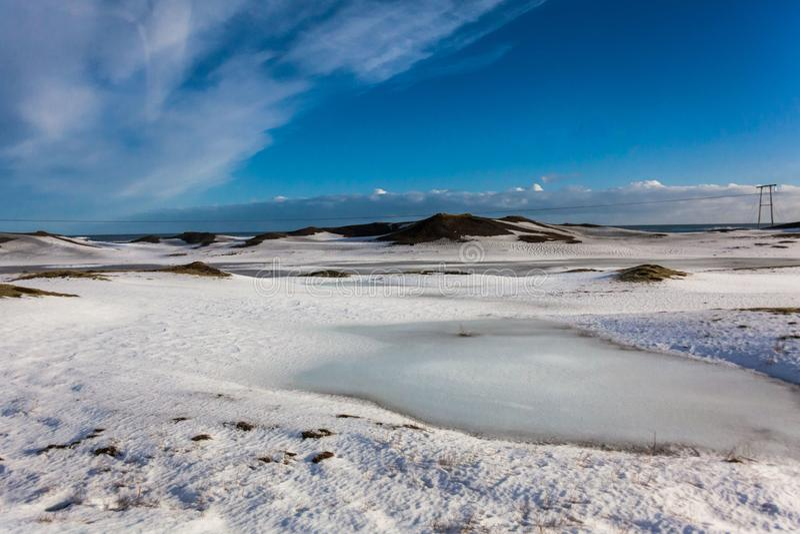 Jokulsarlon snow landscape in Hvannadalshnukur. Jökulsárlón is a glacial lagoon, bordering Vatnajökull National Park in southeastern Iceland. Its stock image