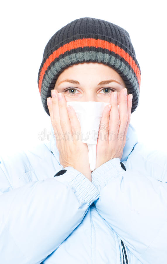 Joli éternuement de femme. grippe photographie stock