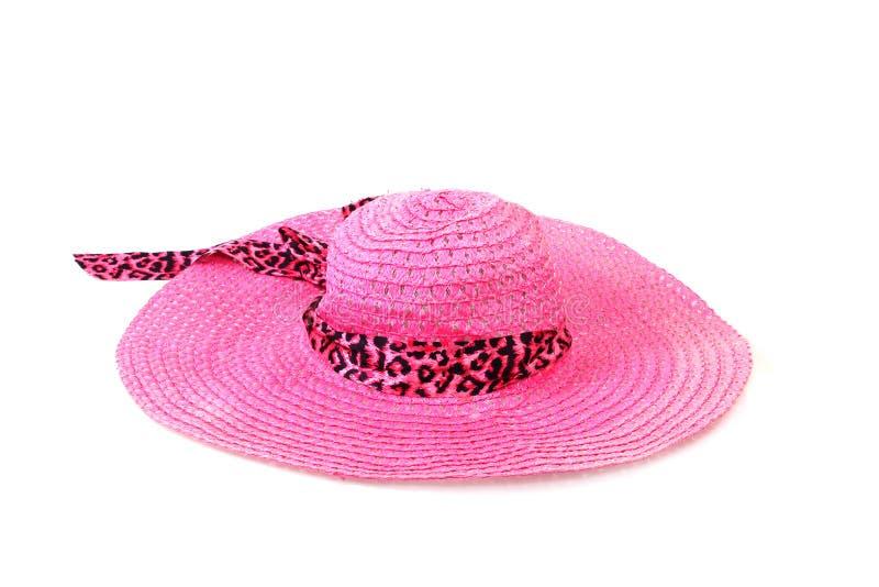 Joli chapeau de paille avec le ruban et arc sur le fond blanc photos libres de droits