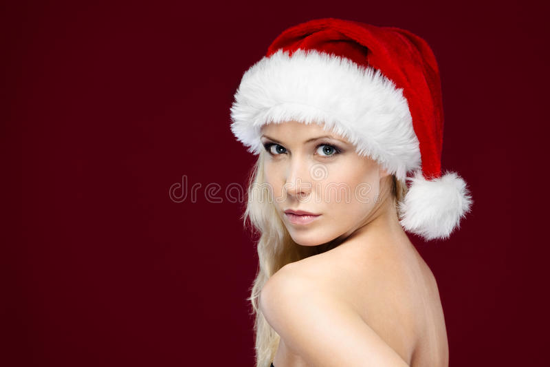 Joli femme dans le capuchon de Noël image stock