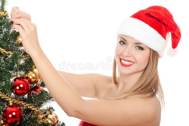 Joli femme rectifié comme Santa image stock