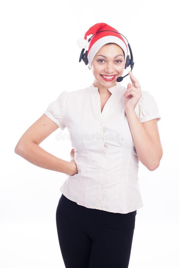 Joli opérateur de téléphone dans le chapeau de Santa d'isolement au-dessus du blanc photos stock