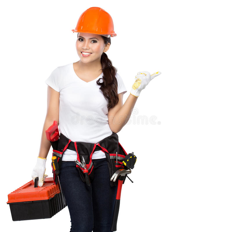 Joli travailleur de la construction de jeune femme image stock