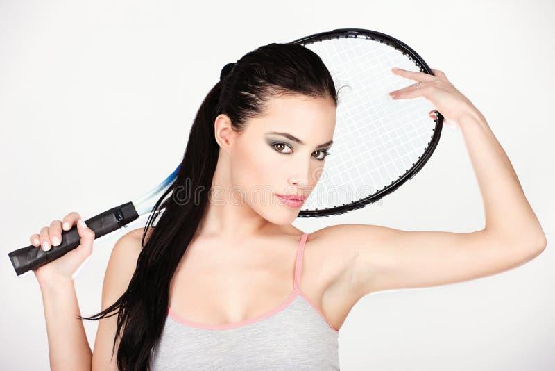 Jolie femme avec la raquette de tennis images libres de droits