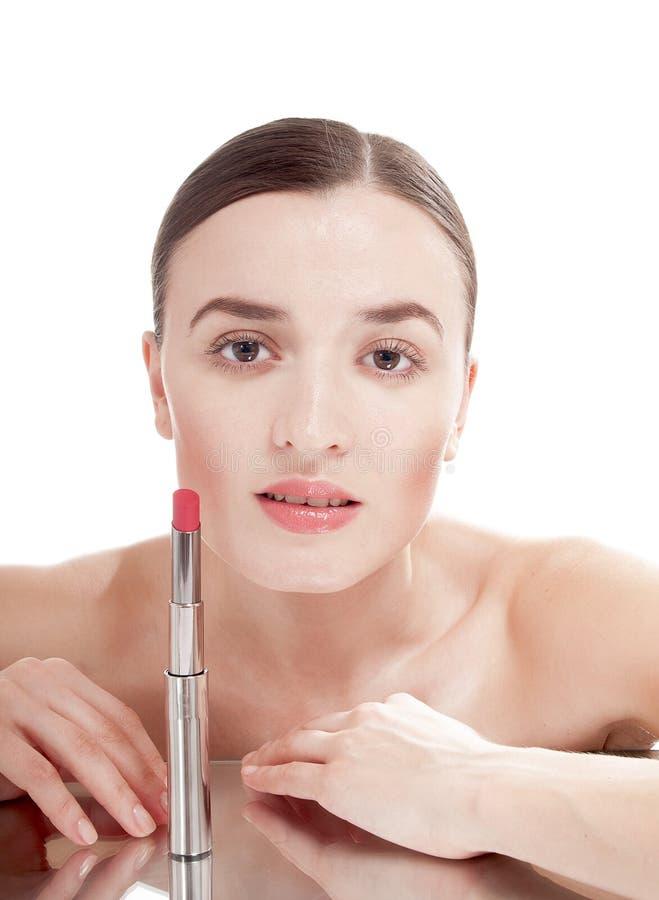 Jolie femme avec le rouge à lèvres rouge. image stock