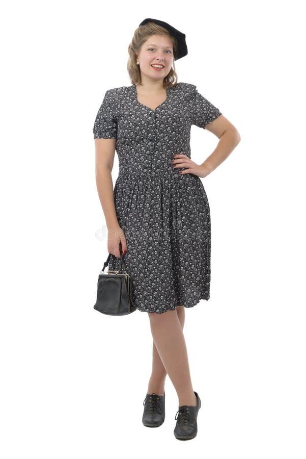 Jolie femme avec le style des vêtements 1940, sur le blanc photo libre de droits
