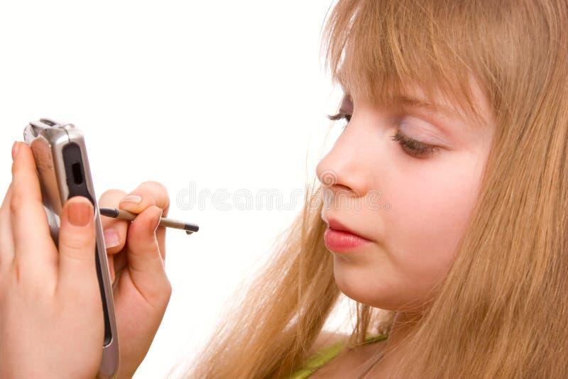 Jolie fille d'adolescent avec l'ordinateur de poche siolated photo stock