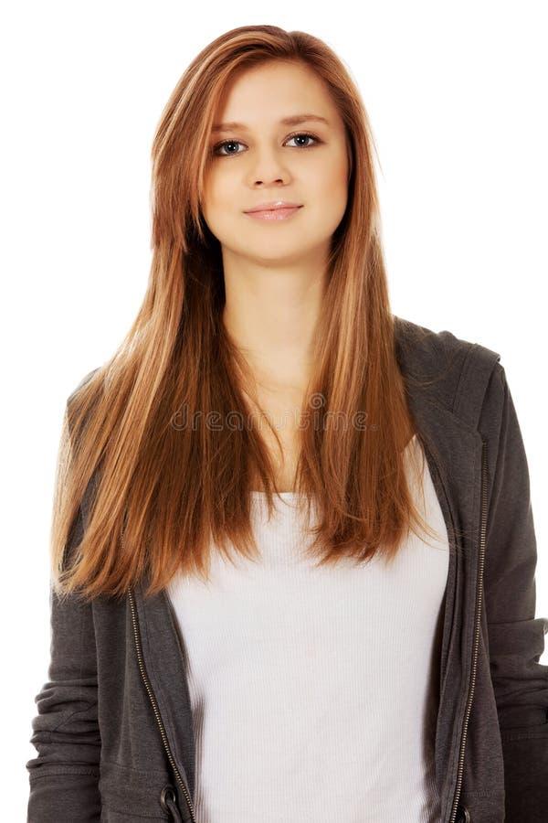 Jolie fille d'adolescent souriant dans l'humeur gaie image stock