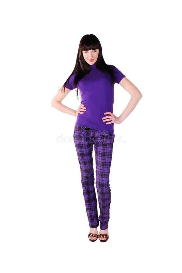 Jolie fille dans des vêtements violets photographie stock