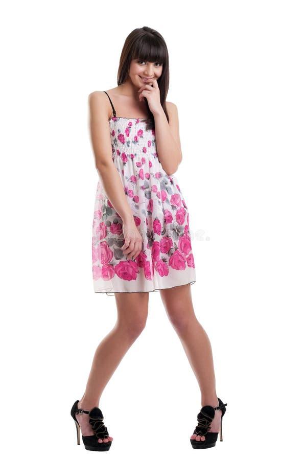 Jolie fille dans la robe transparente d'été cofused image stock