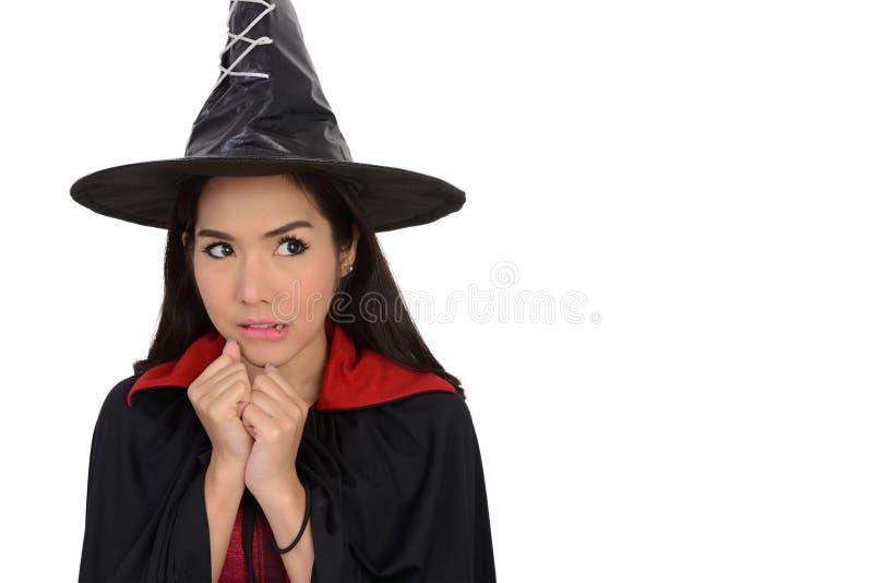 Jolie fille dans le costume de sorcière photographie stock libre de droits