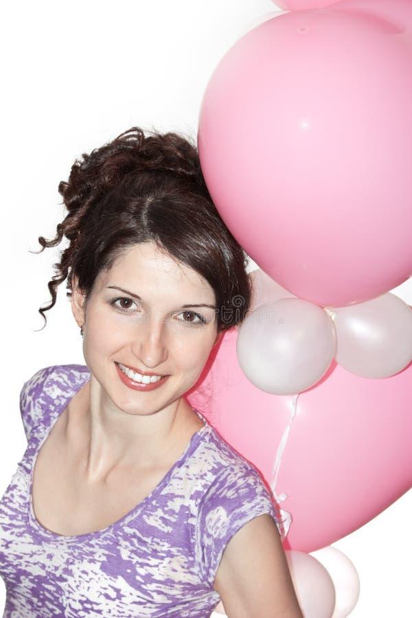 Jolie fille de sourire avec des ballons photographie stock libre de droits