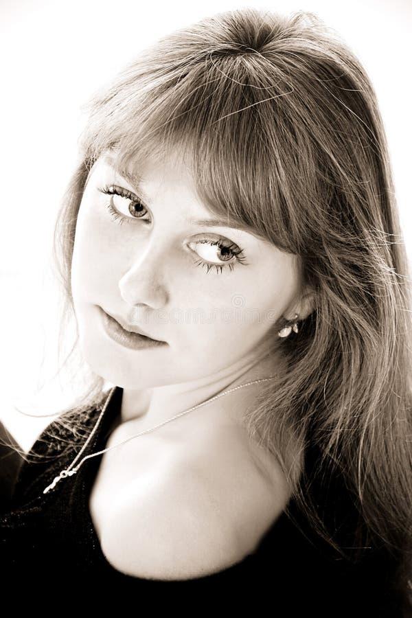 Jolie fille pensante photographie stock libre de droits