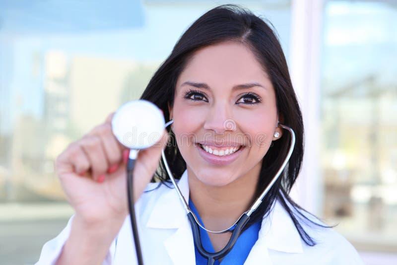 Jolie infirmière avec le stéthoscope image stock