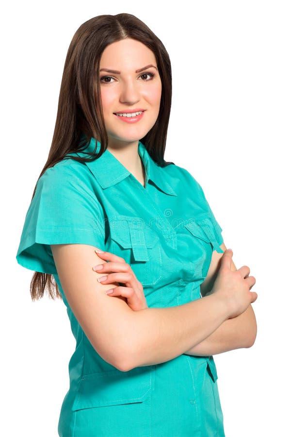 Jolie infirmière de sourire dans l'uniforme image stock