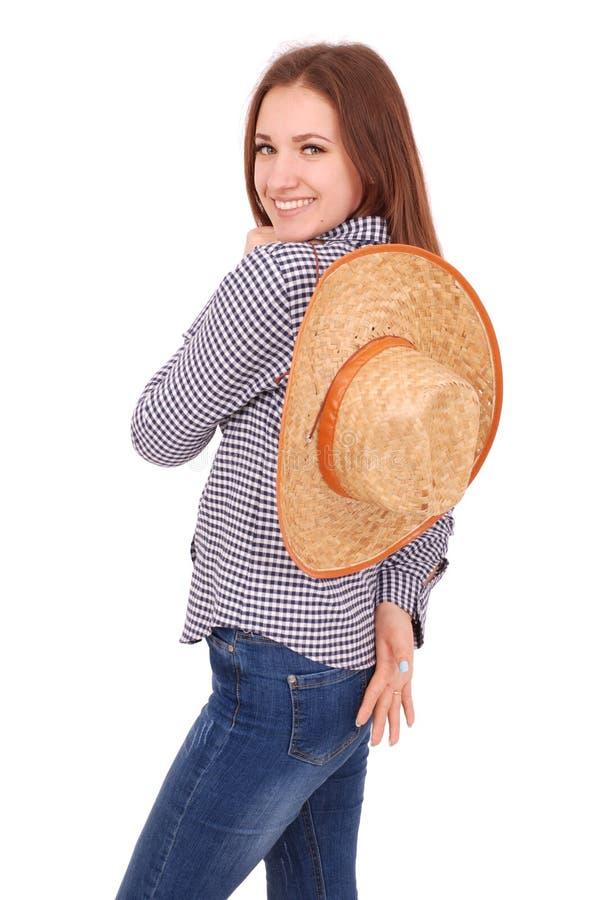 Jolie jeune femme utilisant un grand chapeau souple du soleil de paille photographie stock