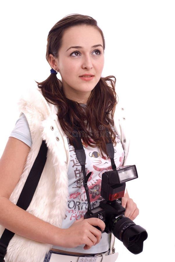 Jolie verticale de fille avec l'appareil-photo moderne de photo photographie stock libre de droits