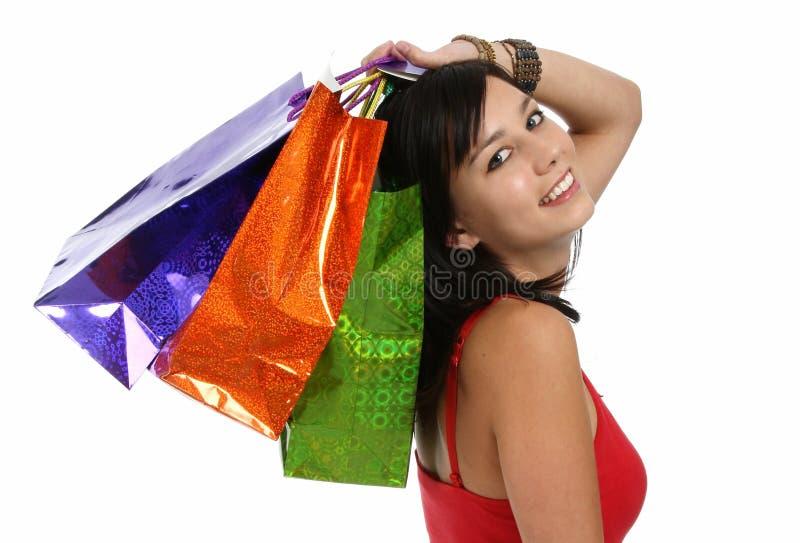 Jolis fille et sacs d'achats photographie stock