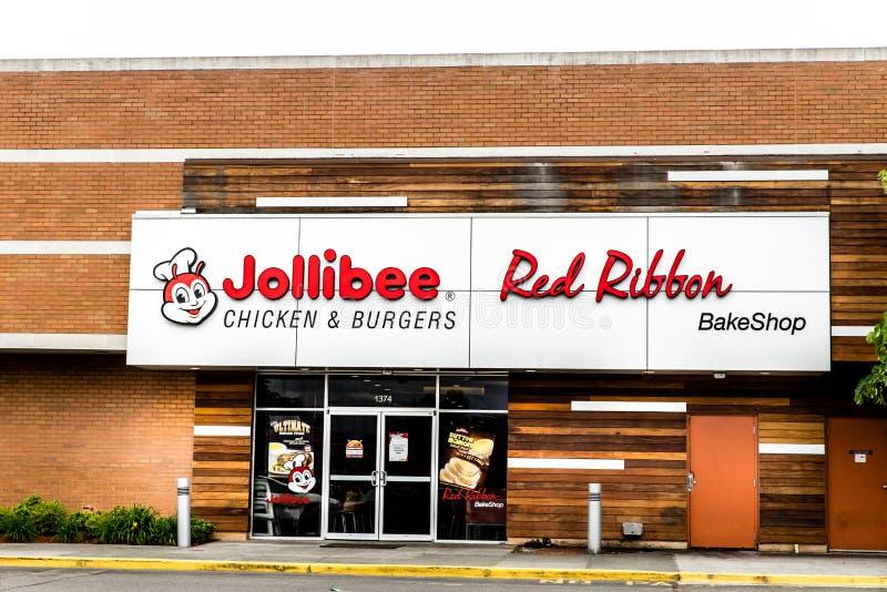 Jollibee restaurang och röd bandbakeshopskyltfönster royaltyfri foto