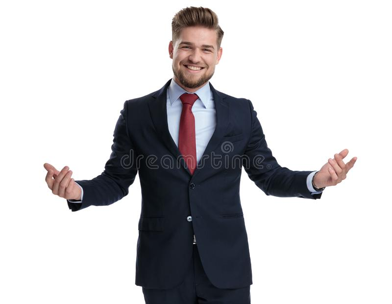Jolly businessman laughing and welcoming with his arms wide open royalty free stock photos