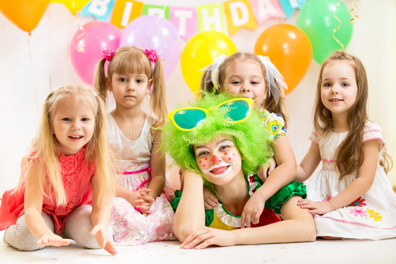 Jolly children and clown on birthday royalty free stock photography
