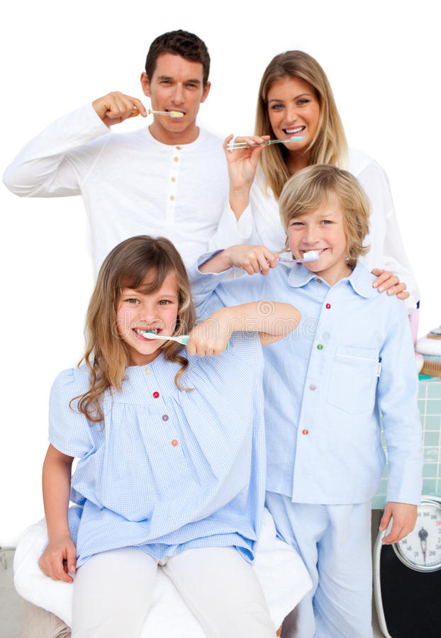 Jolly family brushing their teeth royalty free stock photo