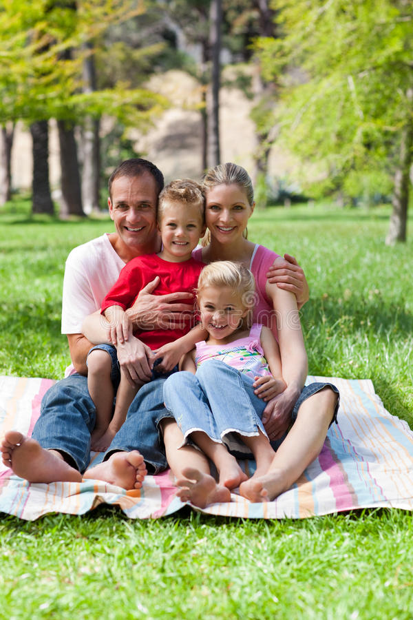 Jolly family at a picnic in a park. Smiling at the camera stock photography