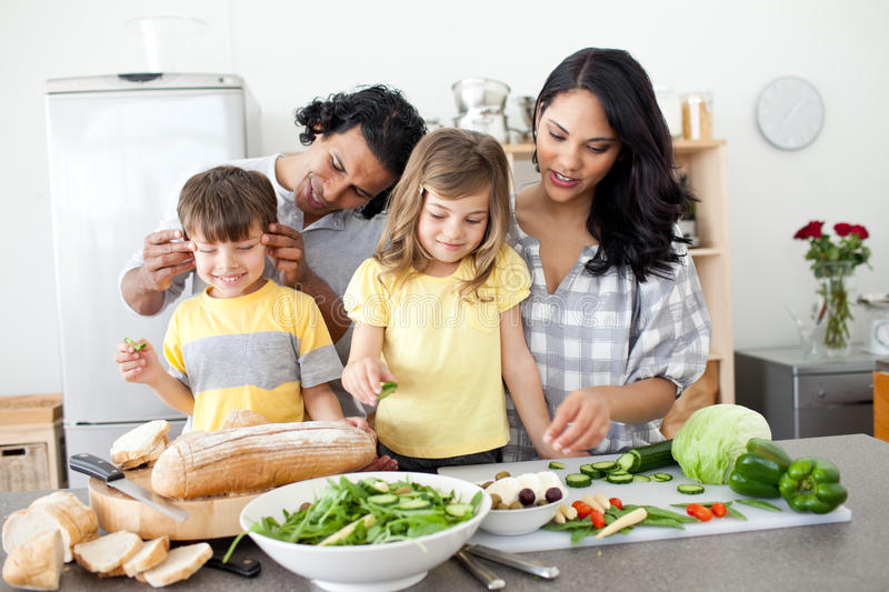 Jolly family preparing lunch together stock photography
