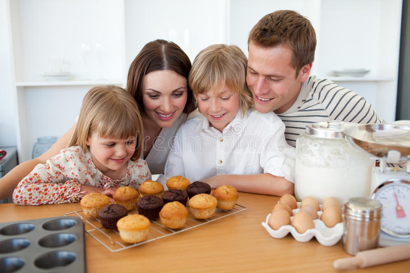 Jolly family presenting their muffins stock photo