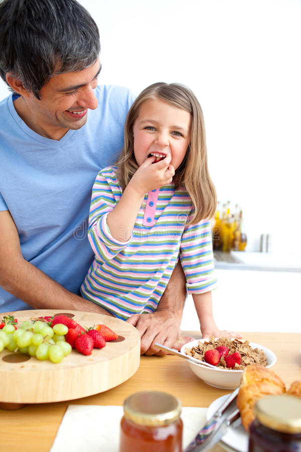 Jolly Father And His Daughter Having Breakfast Stock Photos