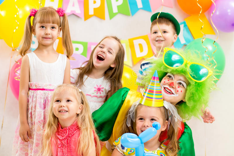 Download Jolly Kids Group And Clown On Birthday Party Royalty Free Stock Photography - Image: 34560957