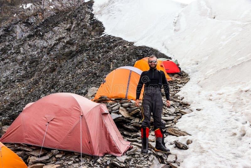 Jolly Mountain Climber and High Altitude Camp stock photography