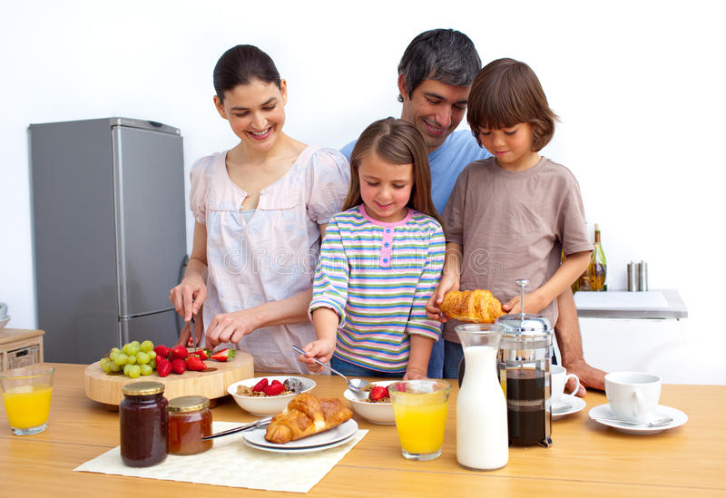 Download Jolly Young Family Having A Breakfast Stock Photo - Image: 12684316