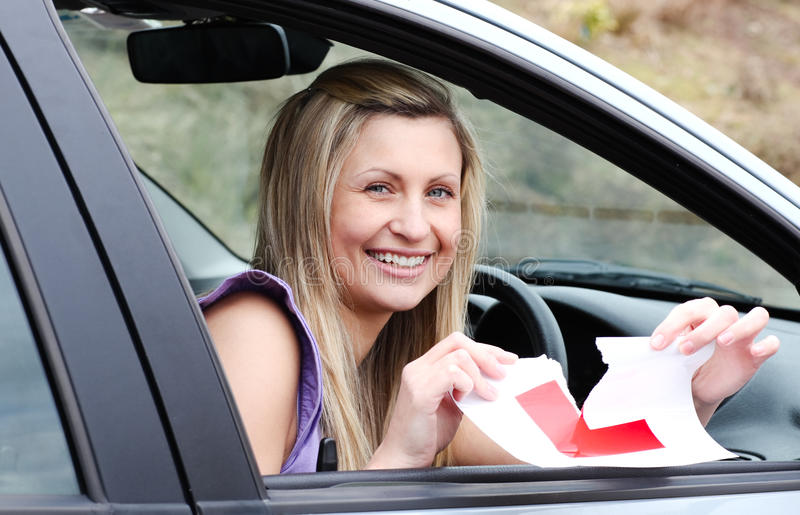 Download Jolly Young Female Driver Tearing Up Her L Sign Stock Photo - Image: 13766876