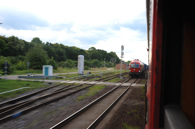 JONAVA, LITHUANIA - JUNE 26, 2011: Lithuania Railway Network and Track. Going on Fast Train. Leaving Station. Lithuania Railway Network and Track. Going on Fast stock photography