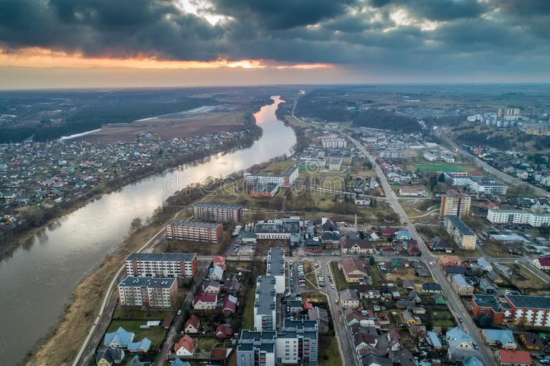 Jonava in Lithuania, river flowing. Aerial panorama view, drone photo of Jonava city in Lithuania. River Neris flowing in spring stock image