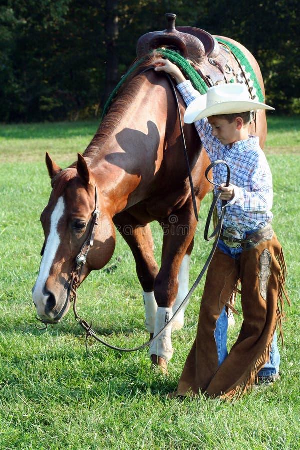 Jong cowboy en paard royalty-vrije stock afbeelding