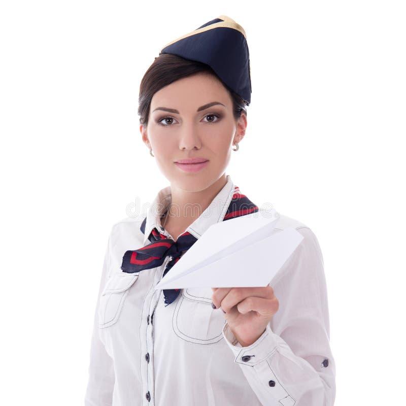Jong die het document van de stewardessholding vliegtuig op wit wordt geïsoleerd royalty-vrije stock foto's