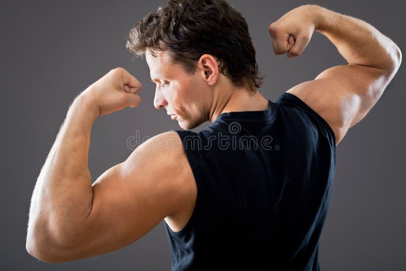 Jong en geschikt mannelijk model stock afbeeldingen
