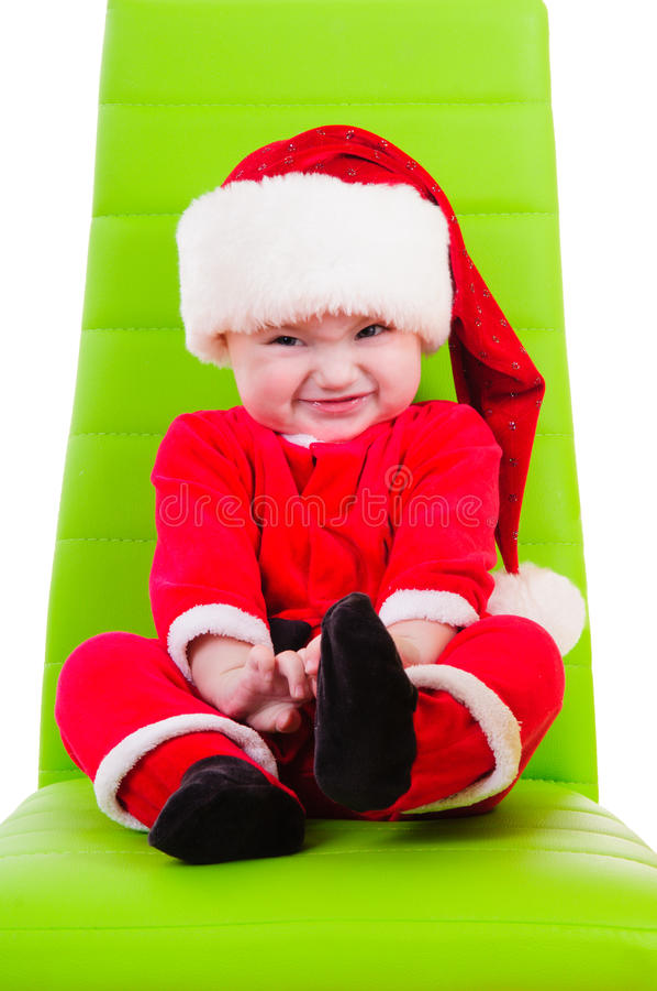 Jong geitje in de kleren van de Kerstman stock foto
