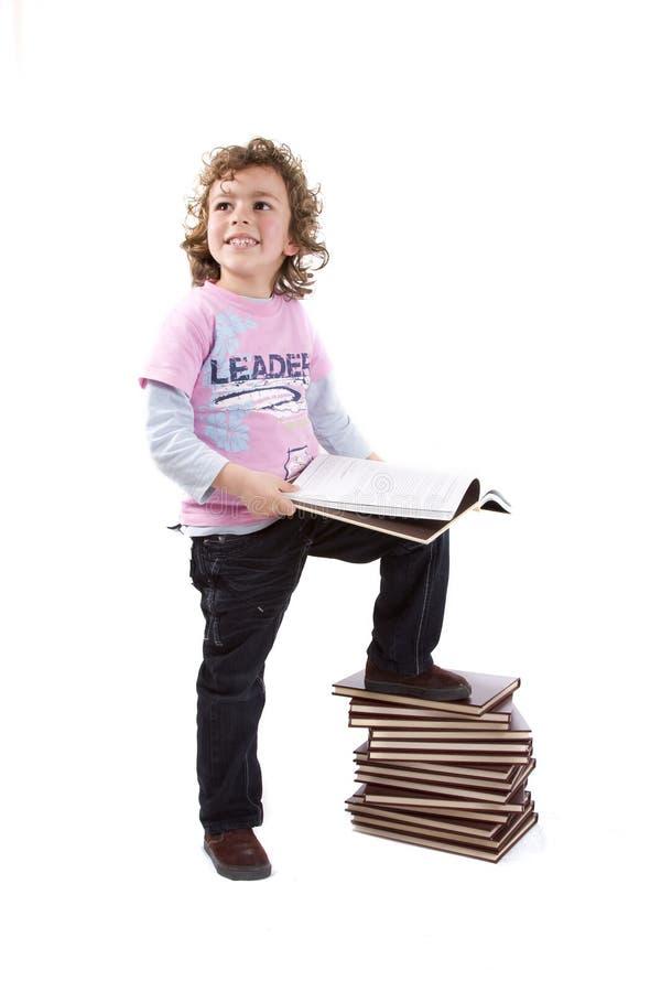 Jong geitje met boeken royalty-vrije stock foto's