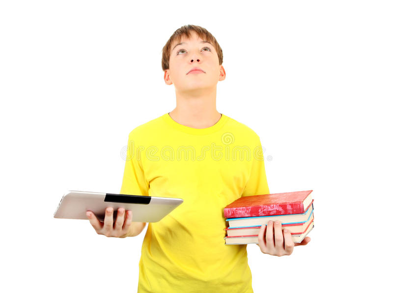 Jong geitje met Boeken en Tablet stock afbeelding