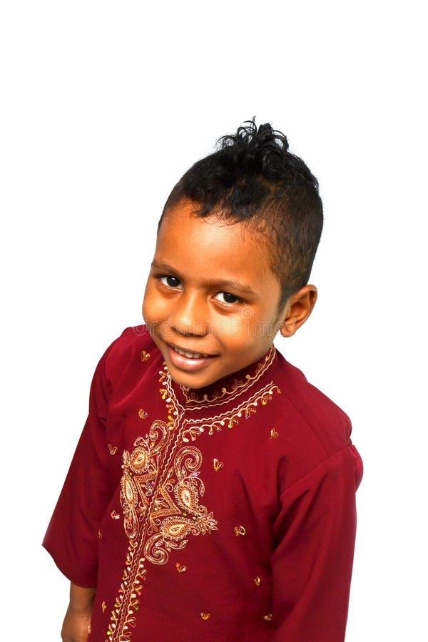Jong geitje in traditionele kleding royalty-vrije stock afbeelding