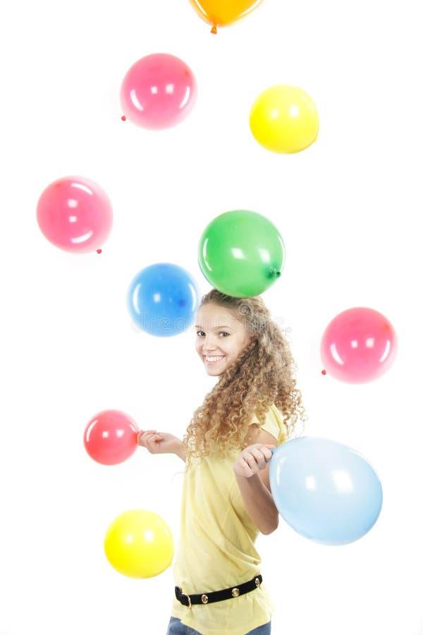 Jong gelukkig meisje met kleurrijke ballons over whit royalty-vrije stock foto